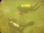 underwater photo of divers mapping the wreck of the Half Moon